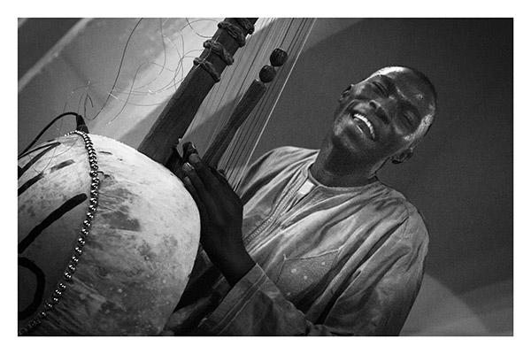 Sasu, Street Musician - possibly the happiest man alive, Sasu's friends told me that broad smile never left his face, The Gambia