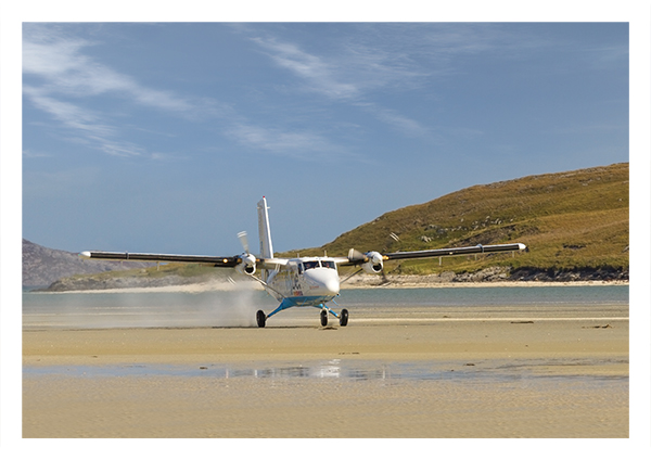 Plane landing at Barra Airport