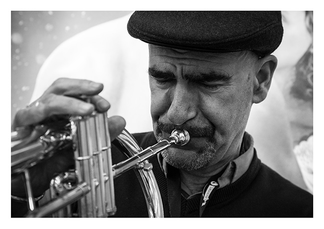 Ted Emmett, trumpet player, busking at Waterloo underground station, London.