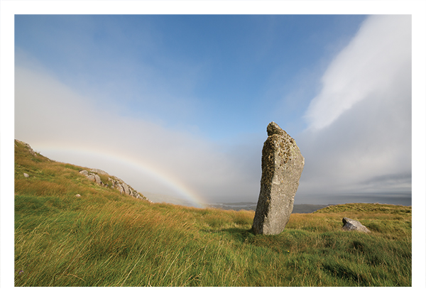 Brevig standing stone with rainbow, Barra
