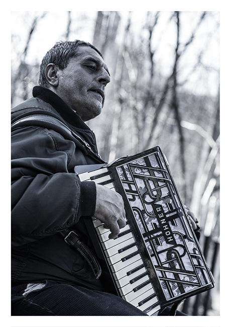 Romanian busker playing the accordion, South Bank, London.