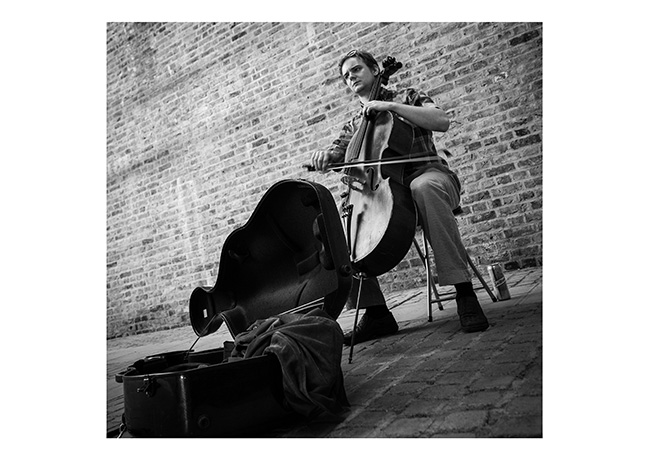 Cello player busking on the South Bank, London.